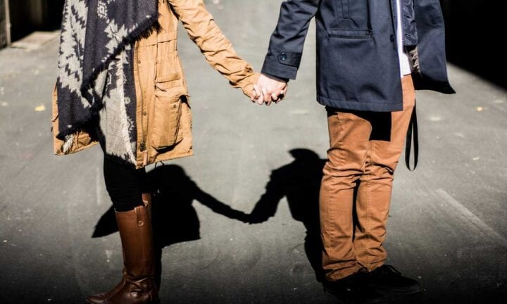 opposite couple holding hands